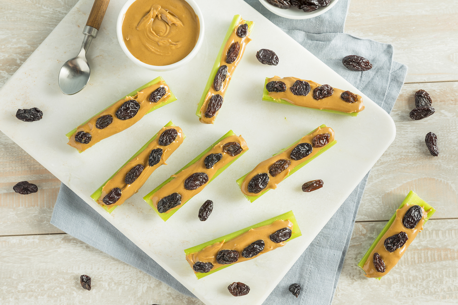 Homemade Ants on a Log Snack with Celery Peanut Butter and Raisins